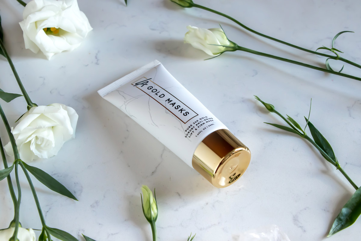 LA Gold Masks Lifestyle Product Photography on White Marble and flowers